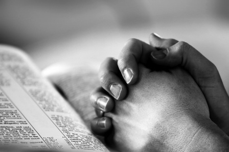 praying-hands-on-bible-black-and-white